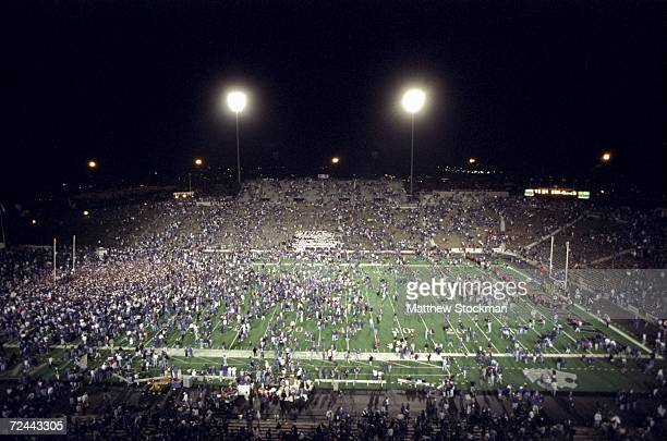 Kansas State Wildcat fans celebrate a victory over the Nebraska Cornhuskers by running onto the field at Wagner Field in Manhattan Kansas The...