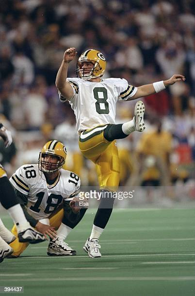 Kicker Ryan Longwell and quarterback Doug Pederson of the Green Bay Packers in action during the game against the Minnesota Vikings at the HHH...