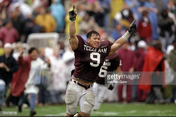 Linebacker Dat Nguyen of the Texas A&M Aggies gestures during the game against the Missouri Tigers at Kyle Field in College Station, Texas. The...