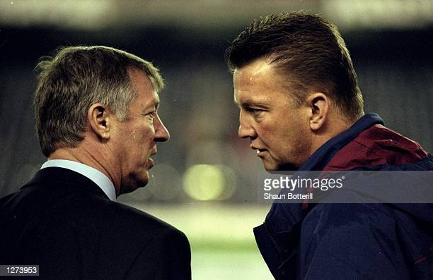 Manchester United manager Alex Ferguson comes face to face with Barcelona coach Louis van Gaal in the UEFA Champions League match at the Nou Camp in...