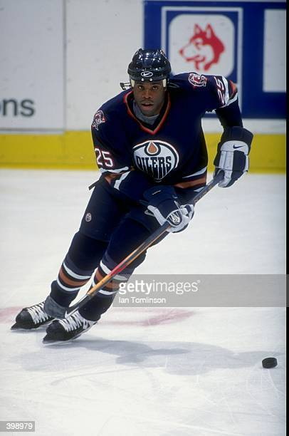 Mike Grier of the Edmonton Oilers in action during the game against the Calgary Flames at the Canadien Airlines Saddledome in Calgary Alberta Canada...