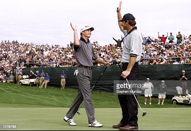 Nick Faldo and David Carter of England celebrate after winning the World Cup of Golf at the Gulf Harbour Golf Club in Auckland, New Zealand. \...