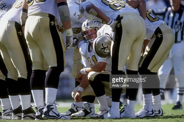 Quarteback Billy Joe Tolliver of the New Orleans Saints in the huddle calling the play during the game against the Carolina Panthers at the Ericsson...