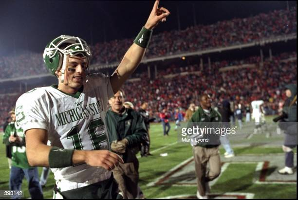 Quarterback Bill Burke of the Michigan State Spartans celebrates following a game against the Ohio State Buckeyes at the Ohio Stadium in Columbus...