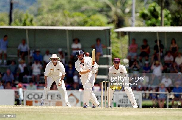 Robert Croft of England on his way to an unbeaten 15 and victory in the Ashes Tour match against Queensland at the Cazaly Australian Football Park in...