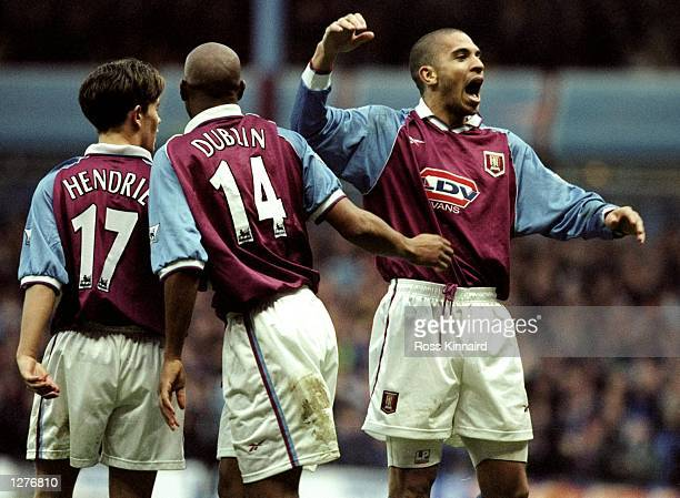 Stan Collymore of Aston Villa celebrates his goal with team mates John Hendrie and Dion Dublin during the FA Carling Premiership match against...