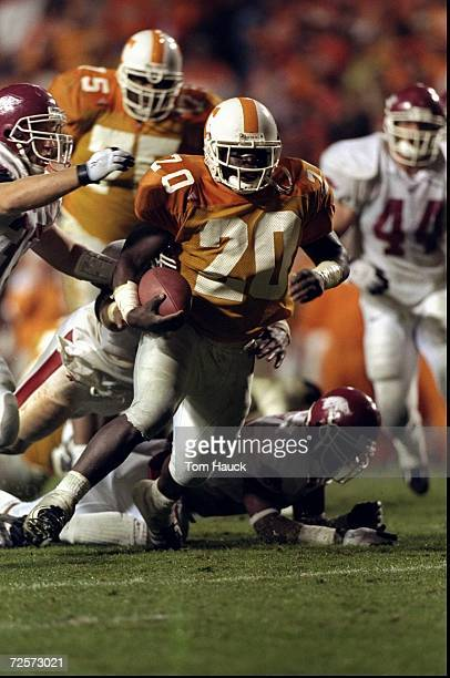 Travis Henry of the Tennessee Volunteers runs with the ball during a game against the Arkansas Razorbacks at the Neyland Stadium in Knoxville,...