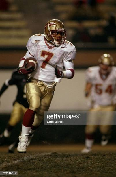 Wide receiver Laveranues Coles of the Florida State Seminoles runs with the ball during a game against the Wake Forest Demon Deacons at the Groves...