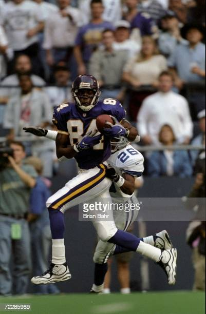 Wide receiver Randy Moss of the Minnesota Vikings runs with the ball during a game against the Dallas Cowboys at the Texas Stadium in Irving Texas...