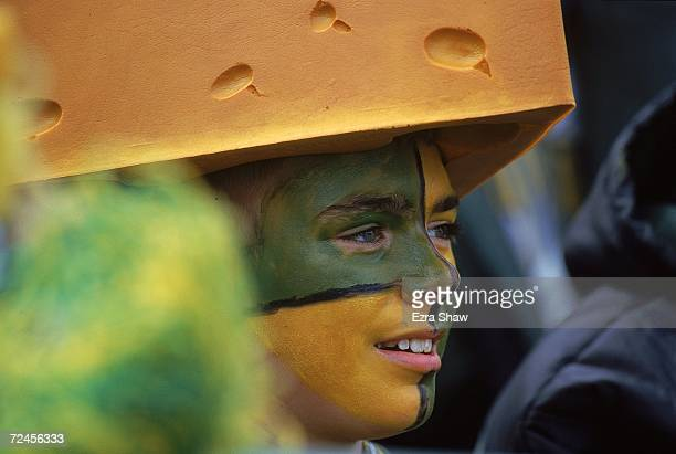 A cheesehead fan of the Green Bay Packers watches during the game against the Detroit Lions at Lambeau Field in Green Bay Wisconsin The Packers...