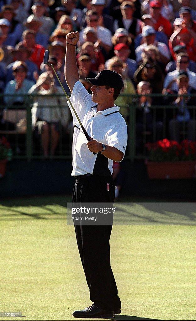 Aaron Baddeley of Australia celebrates winning the Holden Australian Open Golf Trophy at The Royal Sydney Golf Course, Rose Bay, Sydney, Australia. Mandatory Credit: Adam Pretty/ALLSPORT