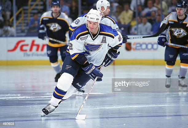 Al MacInnis of the St Louis Blues controls the puck during a game against the Nashville Predators at the Kiel Center in St Louis Missouri The Blues...