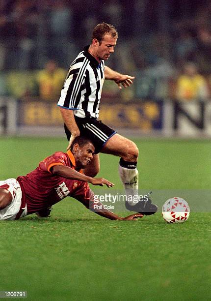 Alan Shearer of Newcastle United goes past Aldair of AS Roma during the UEFA Cup Third Round First Leg match at the Stadio Olympico in Rome Italy...
