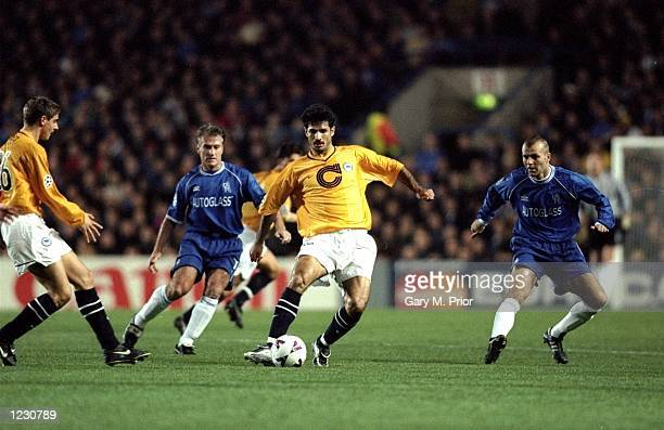 Ali Daei of Hertha Berlin is closely watched by Dider Deschamps and Jes Hogh of Chelsea during the UEFA Champions League Group H match played at...