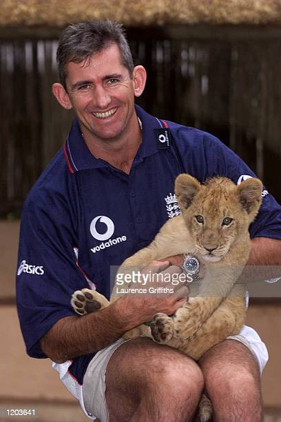 Andrew Caddick of England plays with Lion cubs at the Lion Park in Johannesburg South Africa Mandatory Credit Laurence Griffiths/ALLSPORT