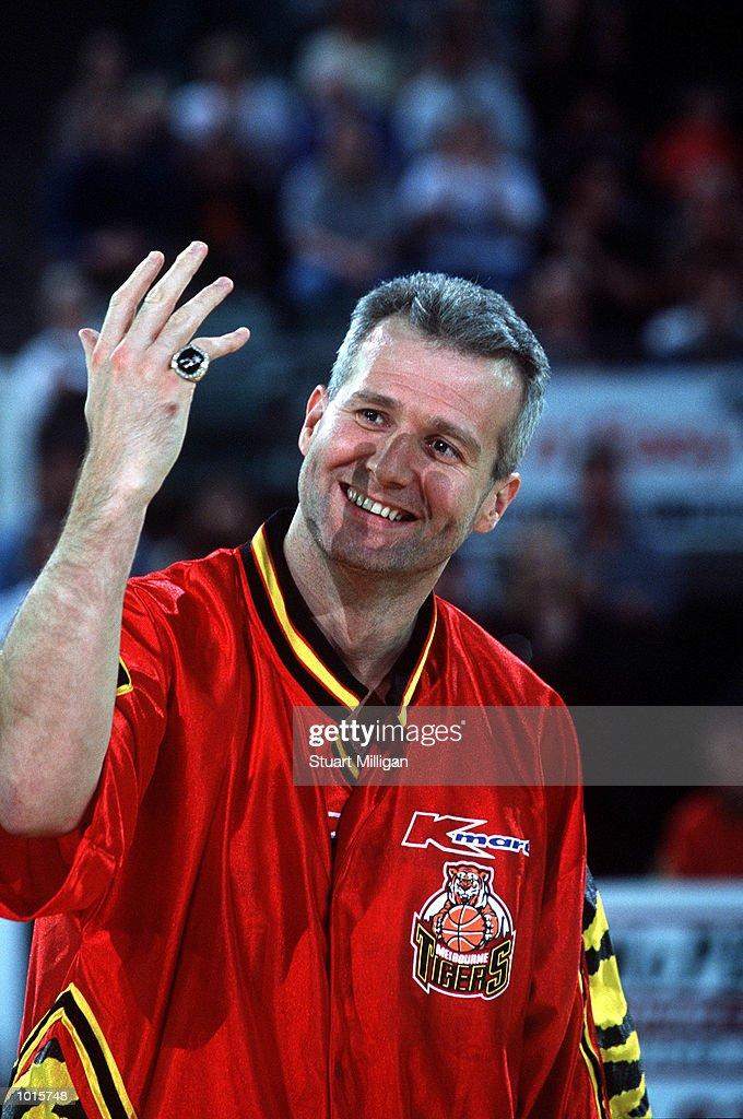 Andrew Gaze of Melbourne Tigers shows his Championship ring to the crowd during the NBL match between Melbourne Tigers v Adelaide 36ers at Melbourne park,Melbourne Australia. Adelaide won 104-84. Mandatory Credit: Stuart Milligan/ALLSPORT