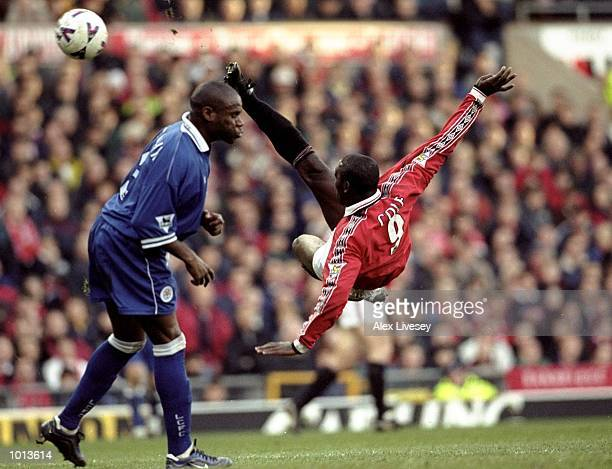 Andy Cole of Manchester United hooks a volley past Frank Sinclair of Leicester City to score during the FA Carling Premiership match at Old Trafford...