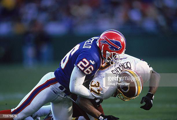 Antoine Winfield of the Buffalo Bills tackles Larry Centers of the Washington Redskins during the game at the Redskins Stadium in Landover Maryland...