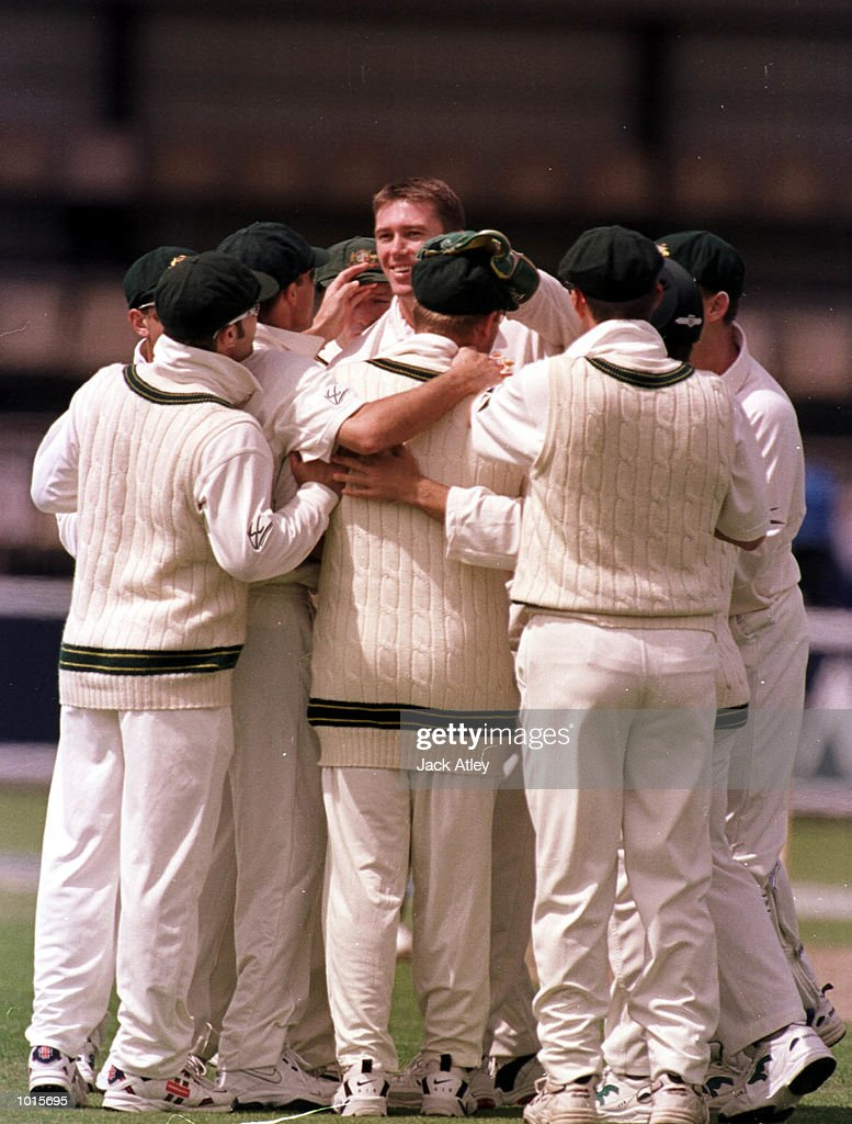 Australain fast bowler Glenn McGrath celebrates with team mates after taking the the wicket of Pakistan batsman Saeed Anwar for no score in the second over, on the first day of the of the second test match between Australia and Pakistan atBellerive Oval,Hobart, Tasmania. Mandatory Credit: Jack Atley/ALLSPORT