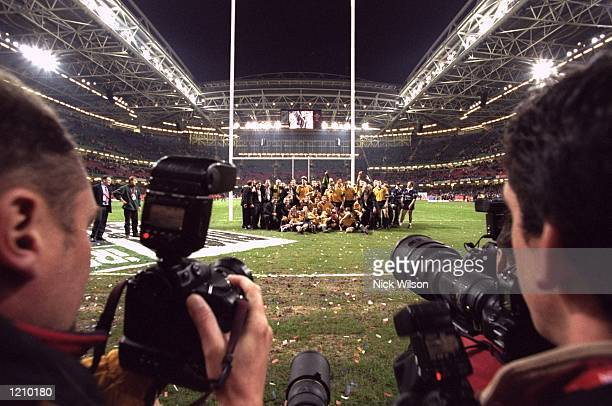 Australia celebrate victory over France in front of the photographers after the Rugby World Cup Final at the Millennium Stadium in Cardiff, Wales....