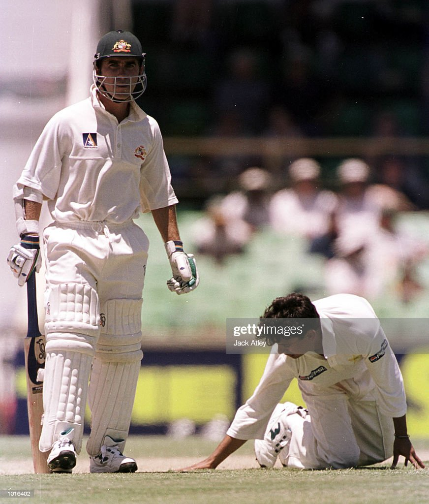 Australian batsman Justin Langer watches on as Pakistan spin bowler Saqlain Mushtaq misfields a shot from Australian batsman Ricky Ponting, during day two of the third test played between Australia and Pakistan at the WACA ground in Perth,Western Australia, Australia. Mandatory Credit: Jack Atley/ALLSPORT