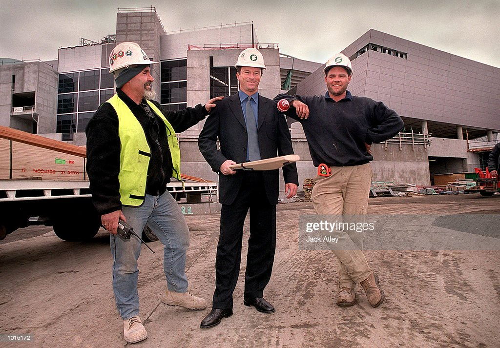 Australian cricket team captain Steve Waugh is met by construction workers at the new Docklands Colonial Sports Stadium in Melbourne, Australia after a press conference to announce that Australia will play South Africa in a one day series atthe new stadium next year. The matches will be played under the enclosed roof of the stadium which is due for completion in February 2000. Mandatory Credit: Jack Atley/ALLSPORT