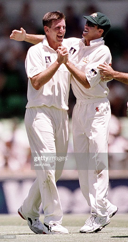 Australian fast bowler Michael Kasprowicz is congratulated by team mate Greg Blewett after taking the wicket of Pakistan batsman Inzimam Ul Haq, during day one of the third test played between Australia and Pakistan at the WACA ground in Perth, Western Australia, Australia. Mandatory Credit: Jack Atley/ALLSPORT