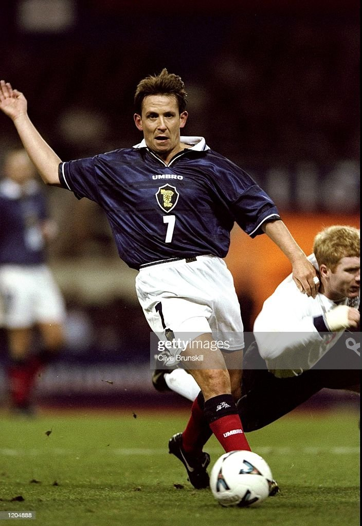 Billy Dodds of Scotland wins the ball from Paul Scholes of England during the Euro 2000 play-off second leg match at Wembley Stadium, London. Scotland won the game 1-0, but England progress to Euro 2000 courtesy of a 2-1 aggregate scoreline. \ Mandatory Credit: Clive Brunskill /Allsport