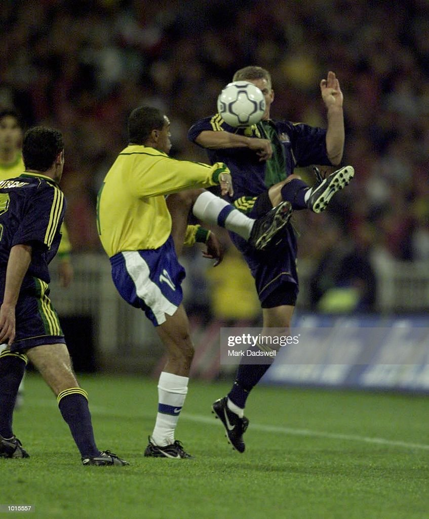 Brazil's #11 Denilson and Australia's #3 Craig Moore contest the ballo during the first half of the Socceroos v Brazil game, played at the MCG, Melbourne, Victoria, Australia. The Socceroos led 1-0 at half time. X Mandatory Credit: Mark Dadswell/ALLSPORT
