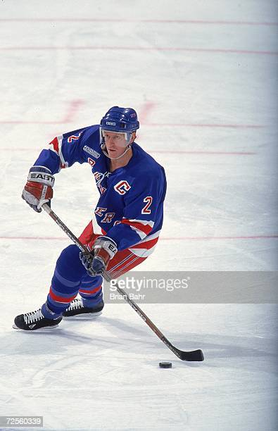 Brian Leetch of the New York Rangers controls the puck during the game against the Colorado Avalanche at the Pepsi Center in Denver Colorado The...