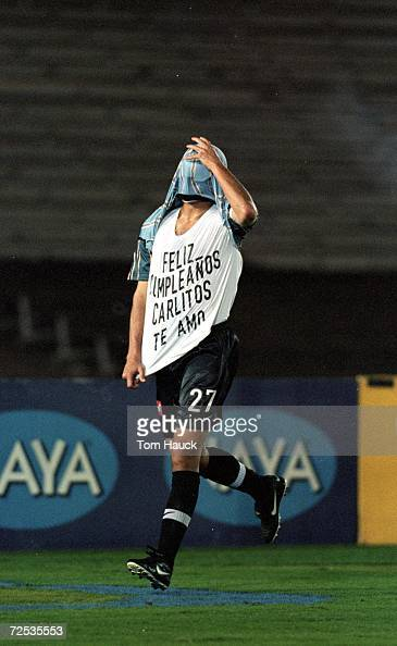 Carlos Hermosillo of the Los Angeles Galaxy runs off the field with his face covered during the MLS Western Conference Final game against the Dallas...