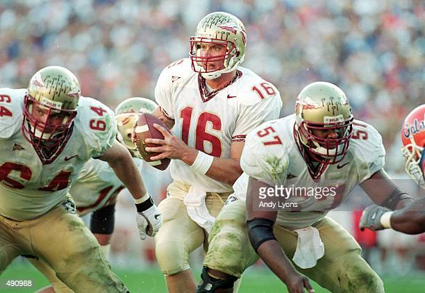 Chris Weinke of the Florida State Seminoles moves with the ball during the game against the Florida Gators at the Ben HillGriffin Stadium in...