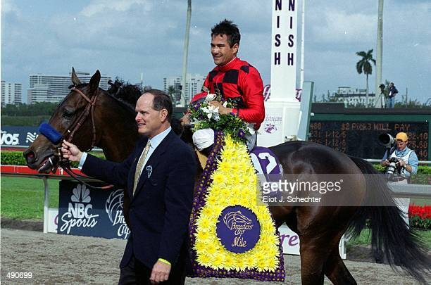 Corey Nakatani rides Silic to the winners circle after the Mile during the Breeders Cup at Gulf Stream Park in Hallandale Beach Florida Mandatory...