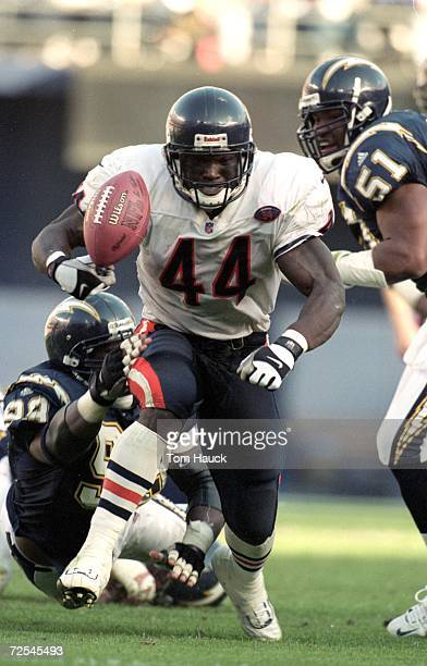 Curtis Enis of the Chicago Bears fumbles the ball during a game against the San Diego Chargers at the Qualcomm Stadium in San Diego California The...