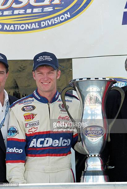 Dale Earnhardt Jr. Poses with the winning trophy after winning the Busch Series during the Hot Wheels.Com 300, part of the NASCAR Busch Series at the...
