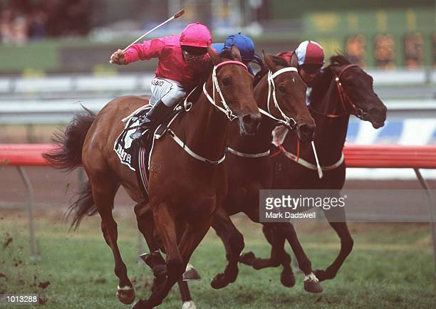 Darren Gauci storms home on Tributes to win the V.R.C Crown Oaks, on Oaks Day, traditionally Ladies Day, held at Flemington Racecourse, Melbourne,...