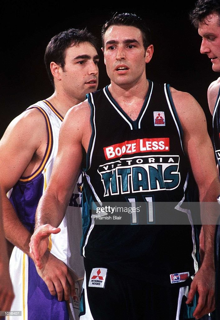Darren Smith (left) of Sydney and Jason Smith of Victoria, twin brothers playing for opposite teams, during the game between Victoria and Sydney at Melbourne Park, Melbourne, Australia. Victoria defeated Sydney 89 - 80. Mandatory Credit: Hamish Blair/ALLSPORT