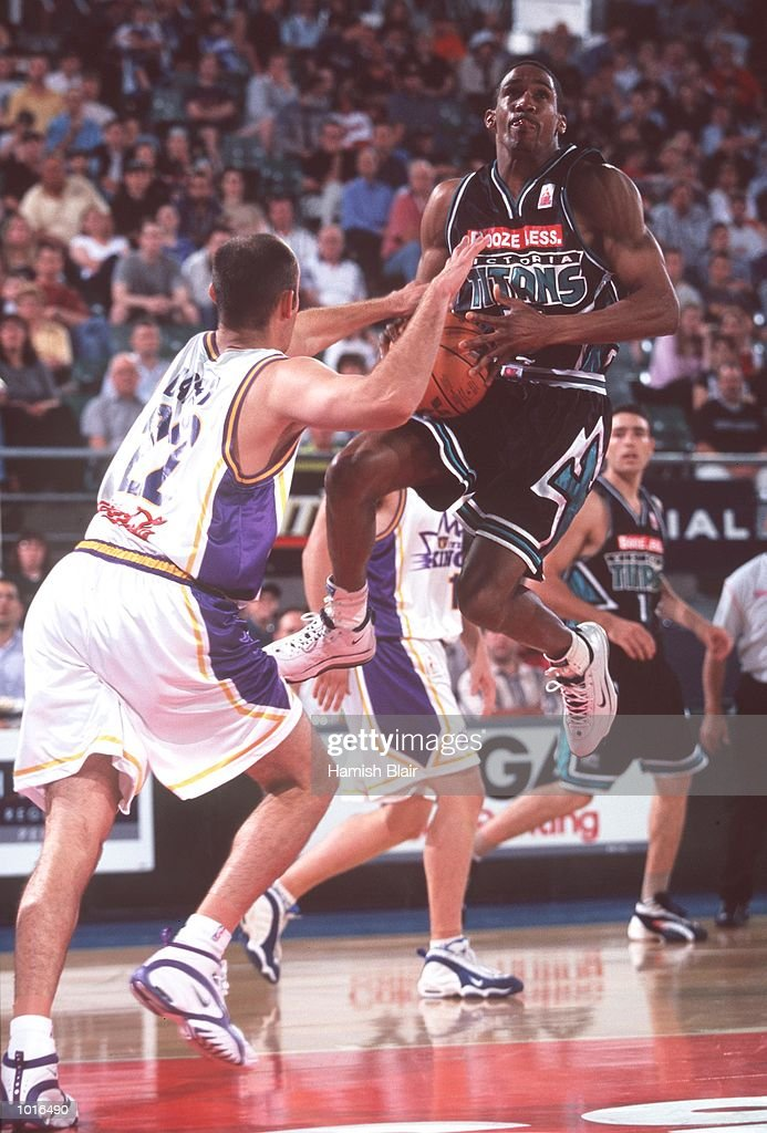 Darryl McDonald of Victoria in the air with Drew Barry of Sydney in close attention, during the game between Victoria and Sydney at Melbourne Park, Melbourne, Australia. Victoria defeated Sydney 89 - 80. Mandatory Credit: Hamish Blair/ALLSPORT