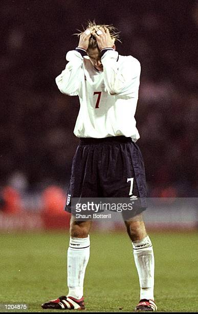 David Beckham of England holds his head as his freekick goes past the post during the England v Scotland Euro 2000 playoff second leg match at...