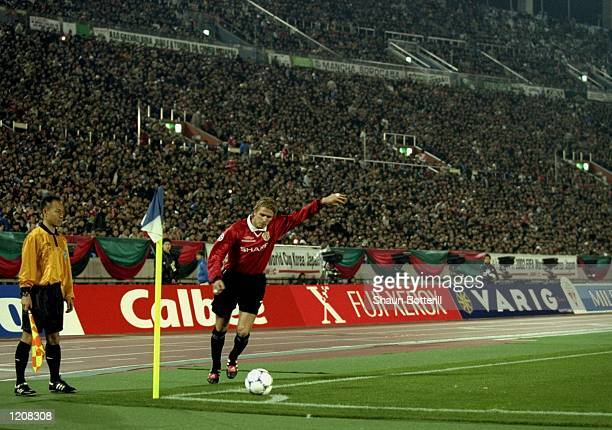 David Beckham of Manchester United takes a corner kick during the Toyota Cup Final against Palmeiras played at the Tokyo Stadium in Tokyo Japan...