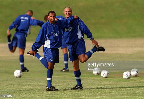 Denilson on left and Ronaldo on right of Brazil in action during training at St Ignatius training ground in the lead up to this Sundays game between...