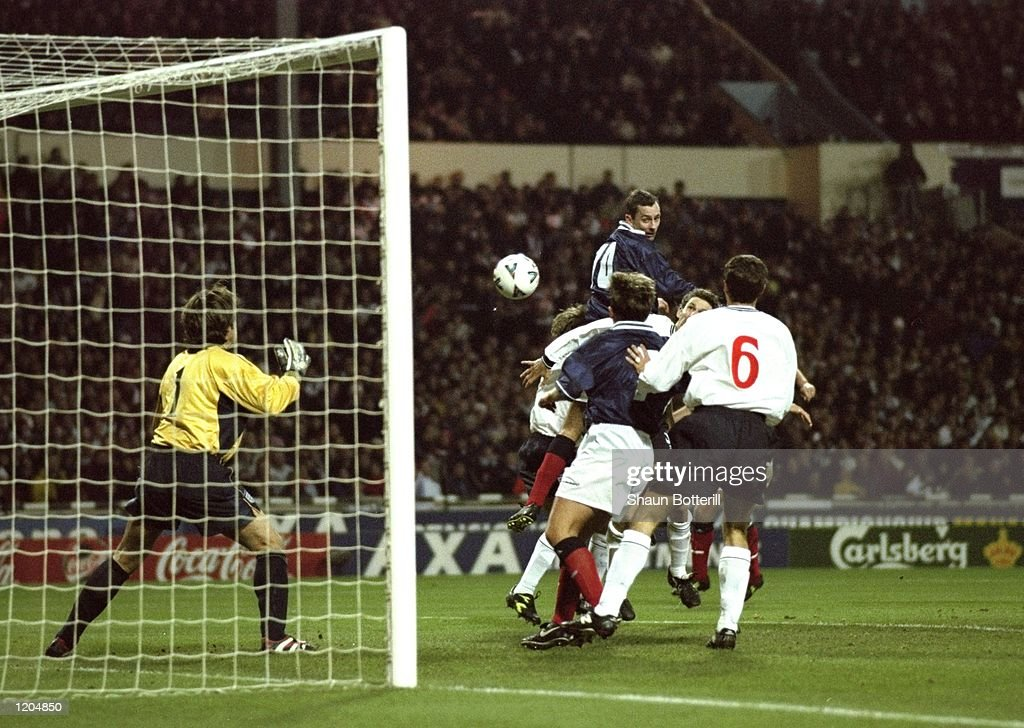 Don Hutchison rises above the England defence to score for Scotland during the Euro 2000 play-off second leg match at Wembley Stadium, London. Scotland won the game 1-0, but England progress to Euro 2000 courtesy of a 2-1 aggregate scoreline. \ Mandatory Credit: Shaun Botterill /Allsport
