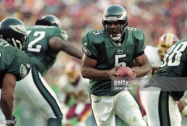 Donovan McNabb of the Philadelphia Eagles moves with the ball during the game against the Washington Redskins at the FedEx Field in Washington DC The...