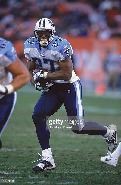 Eddie George of the Tennessee Titans carries the ball during the game against the Cleveland Browns at the Cleveland Browns Stadium in Cleveland Ohio...