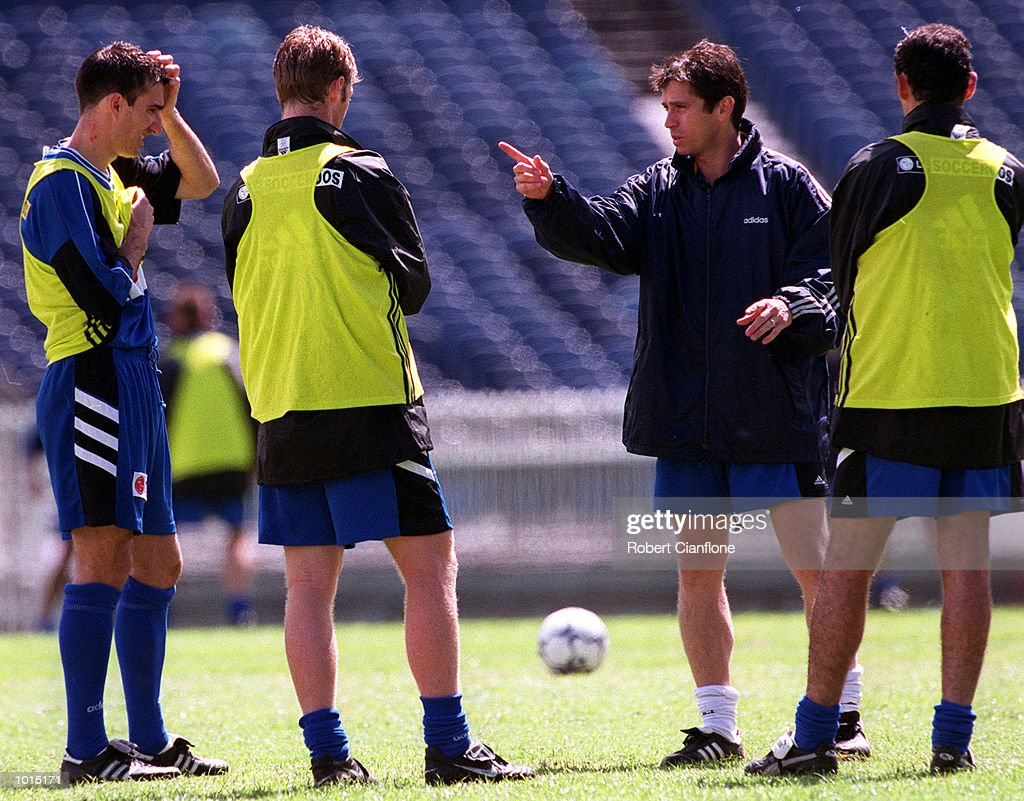 Frank Farina, coach of the Socceroos talks tactics with Tony Vidmar, Craig Moore and Kevin Muscat at this mornings training session at the Melbourne Cricket Ground, in preperation for the match between Australia and Brazil at the Melbourne Cricket Ground tomorrow night. Melbourne Cricket Ground, Melbourne, Australia. Mandatory Credit: Robert Cianflone/ALLSPORT