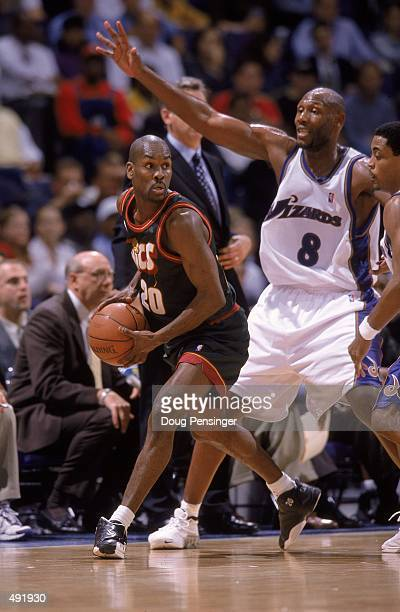 Gary Payton of the Seattle SuperSonics looks to pass the ball during a game against the Washington Wizards at the MCI Center in Washington DC The...