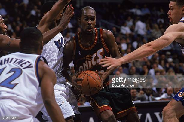 Gary Payton of the Seattle SuperSonics tries to make a layup during the game against the Washington Wizards at the MCI Center in Washington DC The...