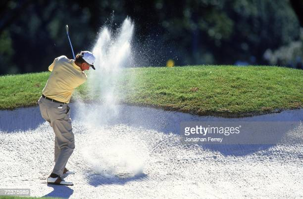 George Archer hitting his ball out of a sand trap during the Senior Tour Championship at Dunes Golfand Beach Club in Myrtle Beach, South Carolina....