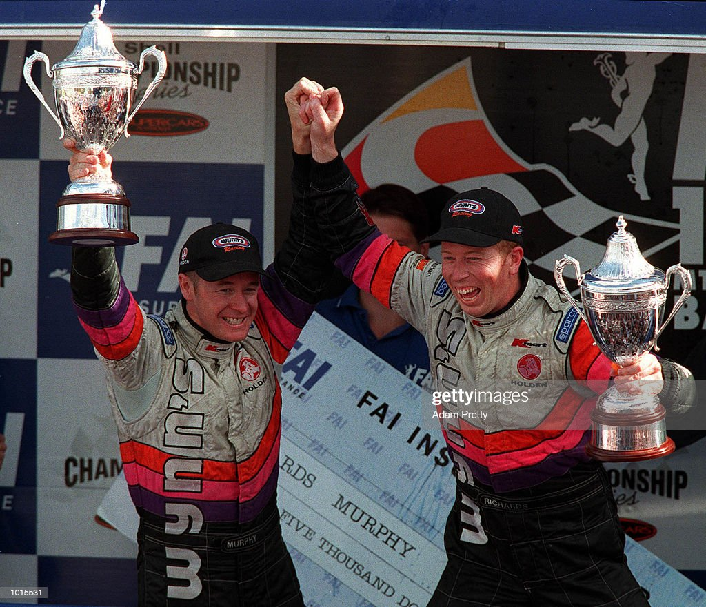 Greg Murphy and Steven Richards from the Wynn's Racing team celebrate after finishing first in the Bathurst FAI 1000 at Mount Panorama,Bathurst Australia. Mandatory Credit: Adam Pretty/ALLSPORT