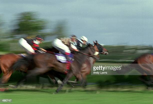 Impression of the Speeding Horses taken in the Filly and Mare Turf during the Breeders Cup at Gulf Stream Park in Hallandale Beach Florida Mandatory...